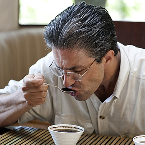 Man tasting coffee