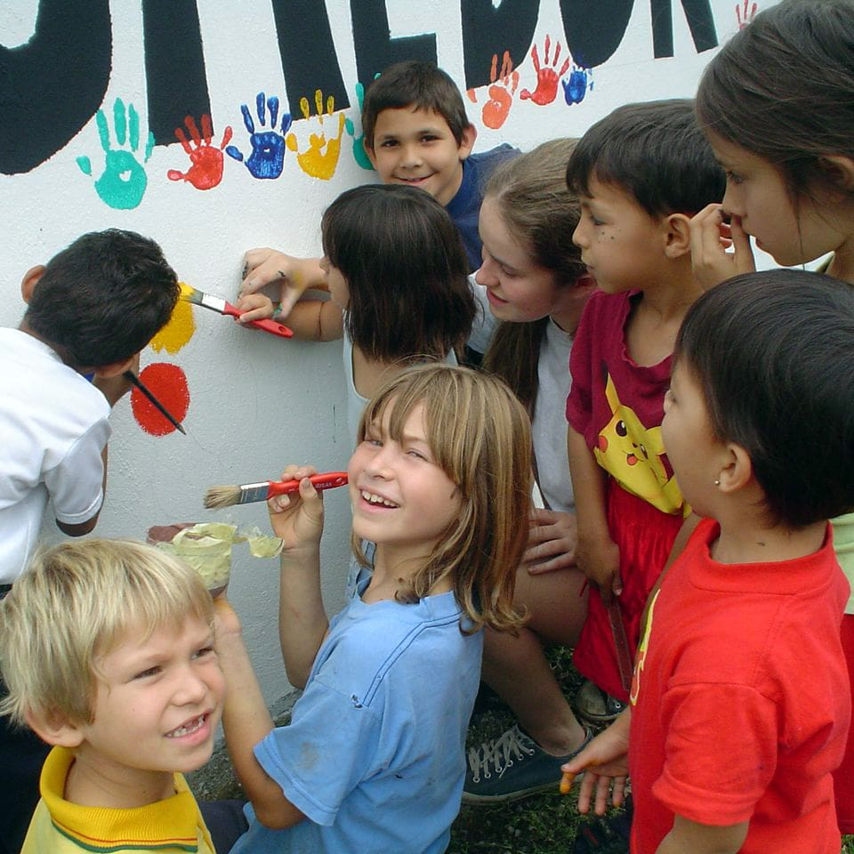 Kids painting on a wall