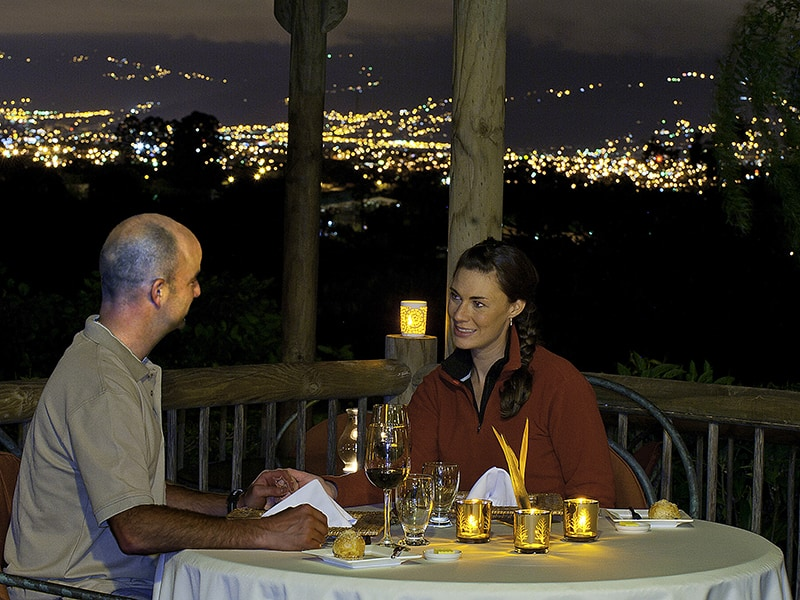 Couple having dinner at night on the terrace