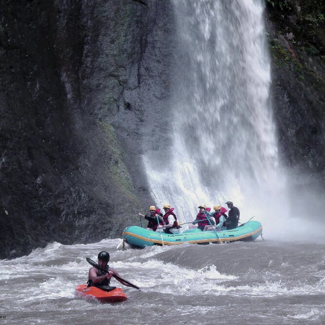 Group rafting on Pacuare river near a waterfall